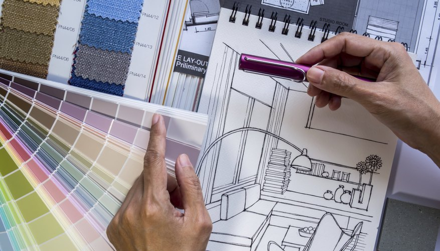 Interior designer's  hand working with illustration sketch and color samples