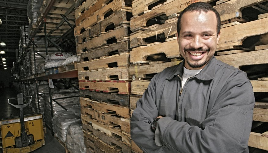 View of a man standing inside a warehouse.