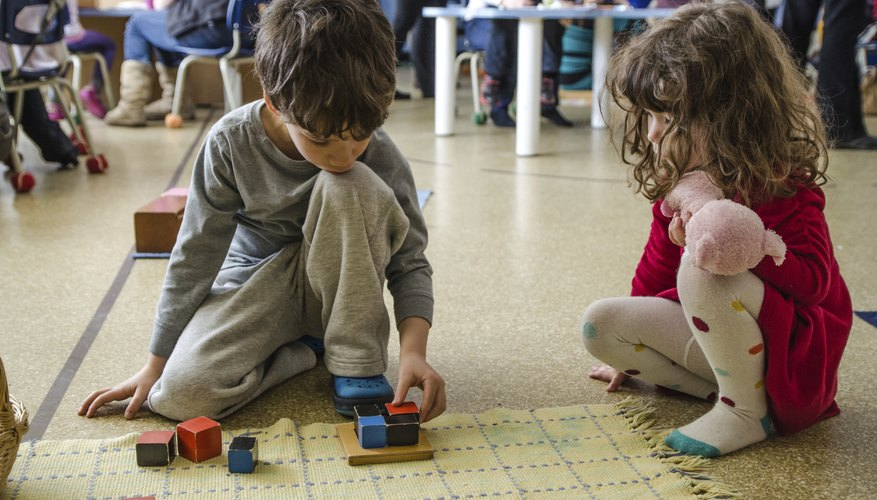 Two preschoolers talking during an activity.