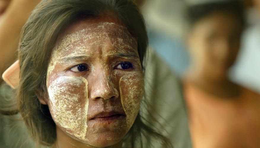 Burmese woman wearing yellow sandalwood paste on skin
