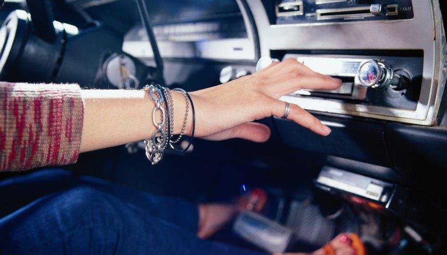 Woman Using Car Stereo