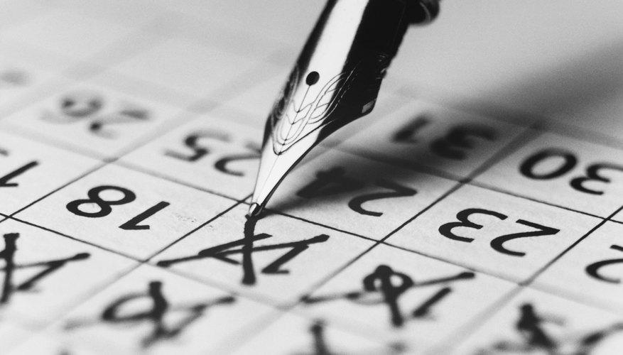 Pen Marking the Days on a Calendar