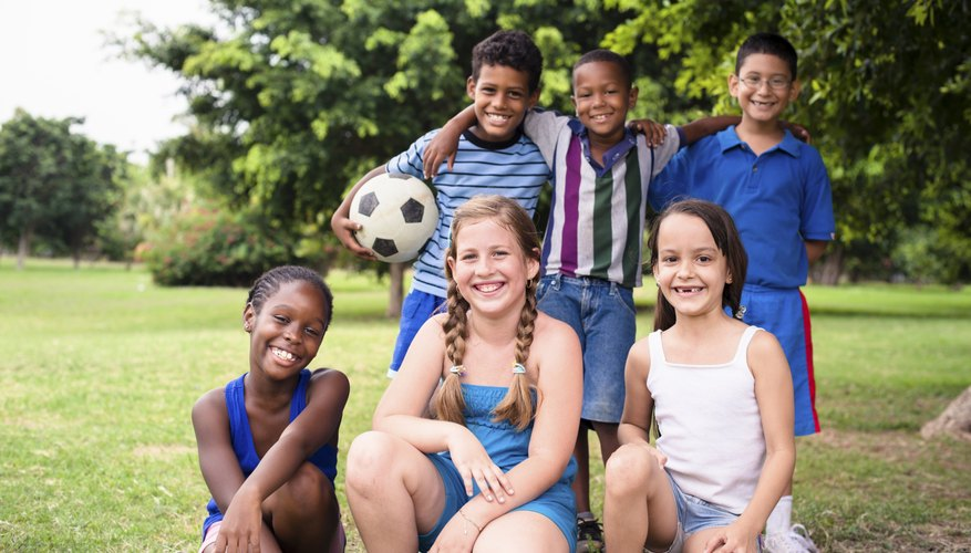 A group of young soccer players pose for a photo.