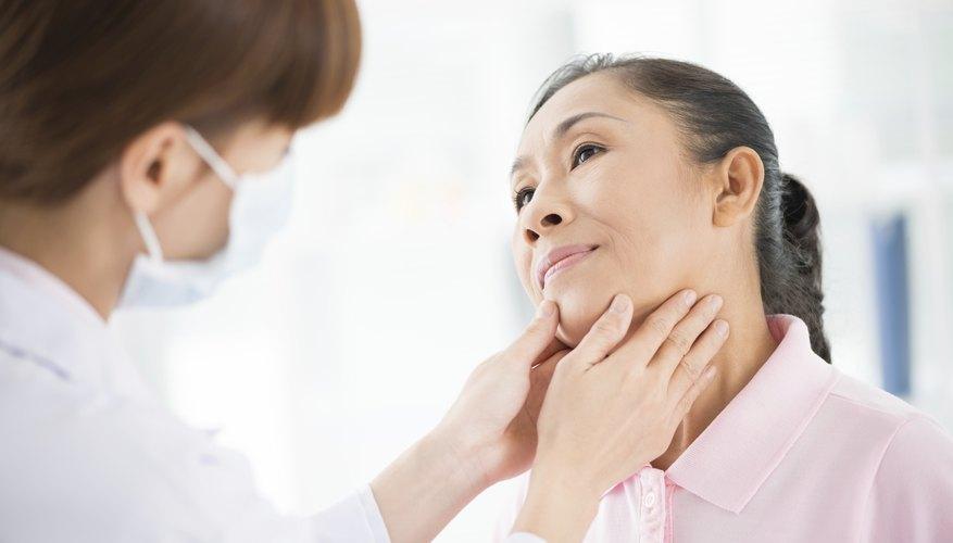 Endocrinologist examing a patient