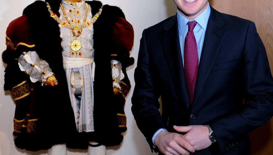 Prince Harry of Wales with a Henry VIII doll.