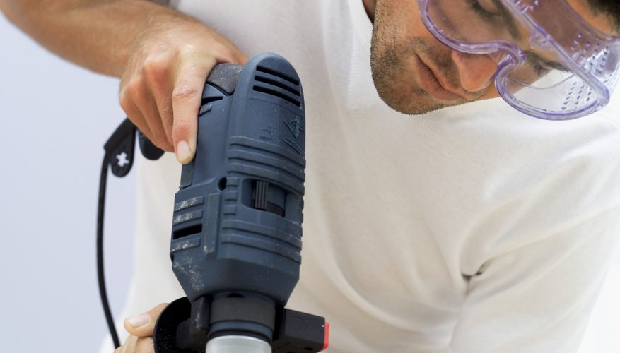 close-up of a man using an electric drill