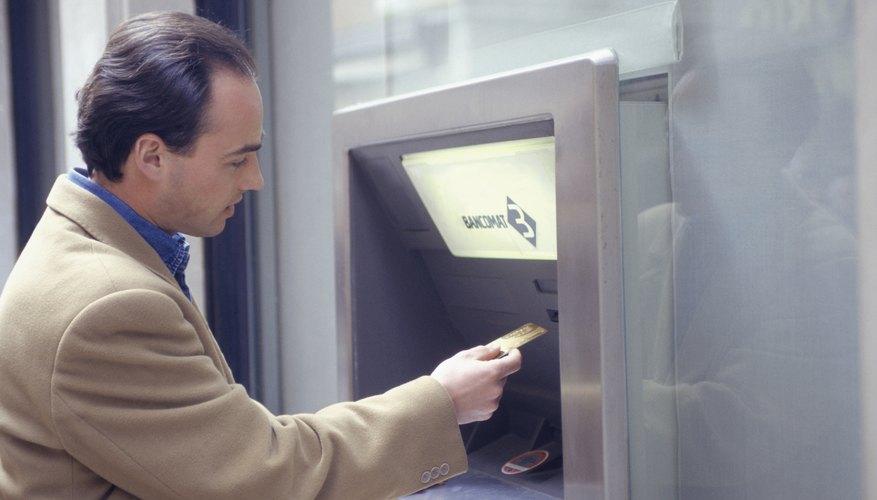 Man at an ATM machine.
