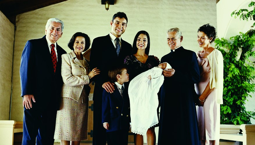 Parents often include family and sponsors in the baby dedication.