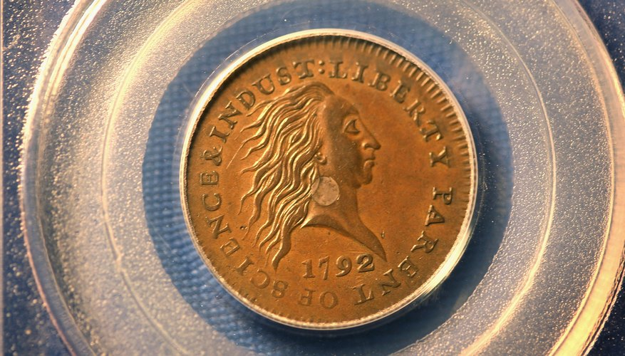 A 1792 U.S. Silver Center Cent in great condition is on display