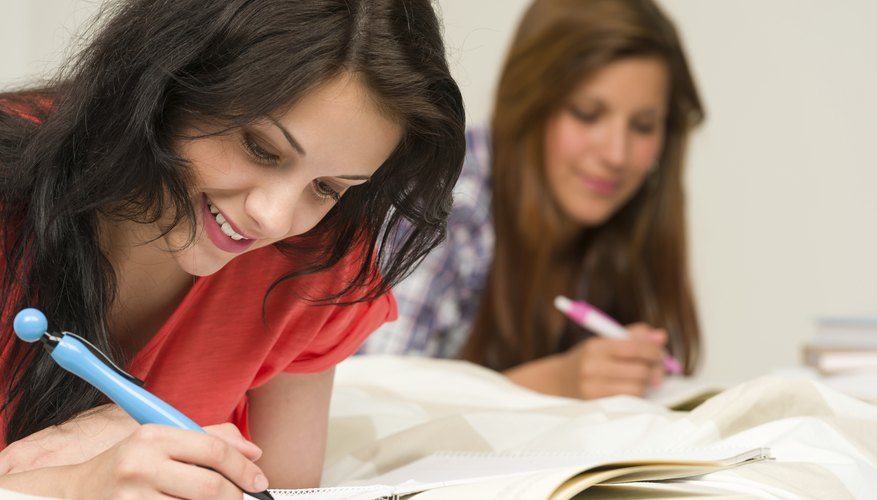 girls writing at boarding school