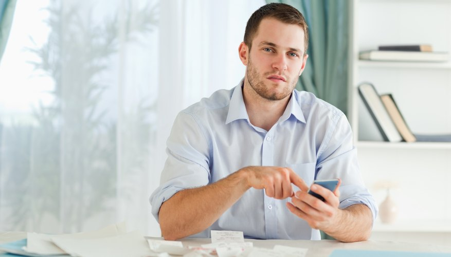 Businessman using his electronic calculator