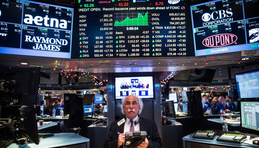 The New York Stock Exchange floor with trading data displays.