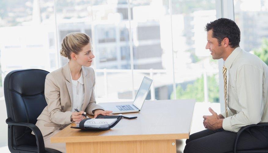 Smiling businesswoman interviewing businessman