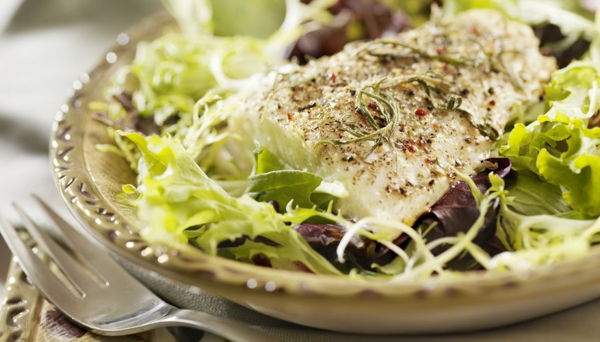 grilled fish on healthy salad