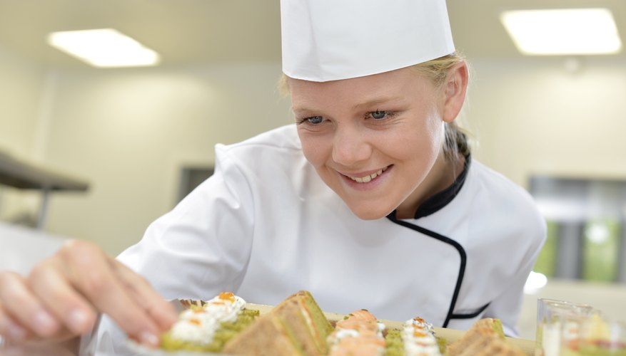 Caterer putting last appetizer on tray