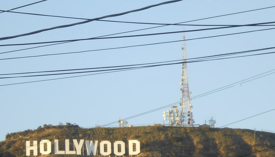 The Hollywood sign on the side of a hill.