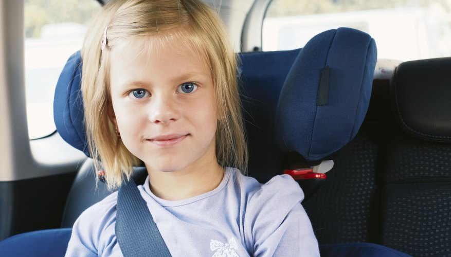 girl in car booster seat
