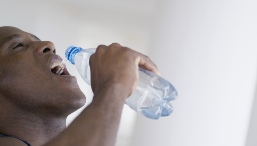 Man chugging a bottle of water.