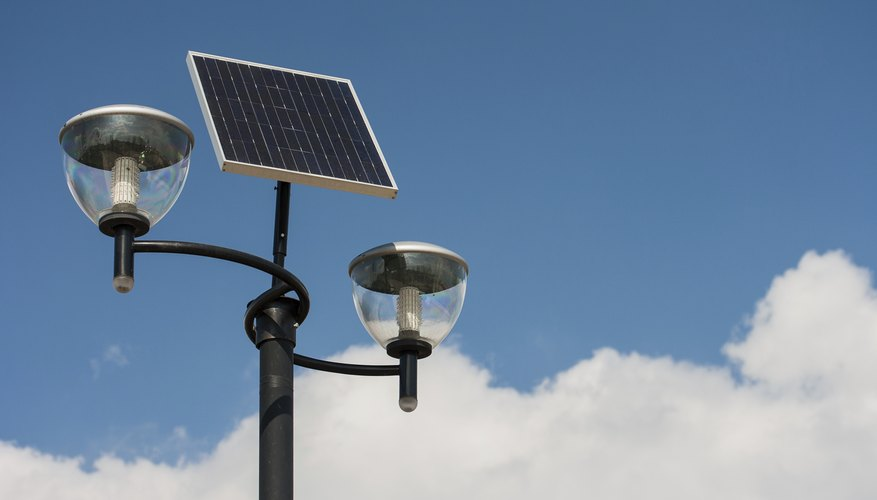 A street lamp powered by solar panels.