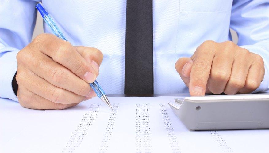Businessman calculating bill