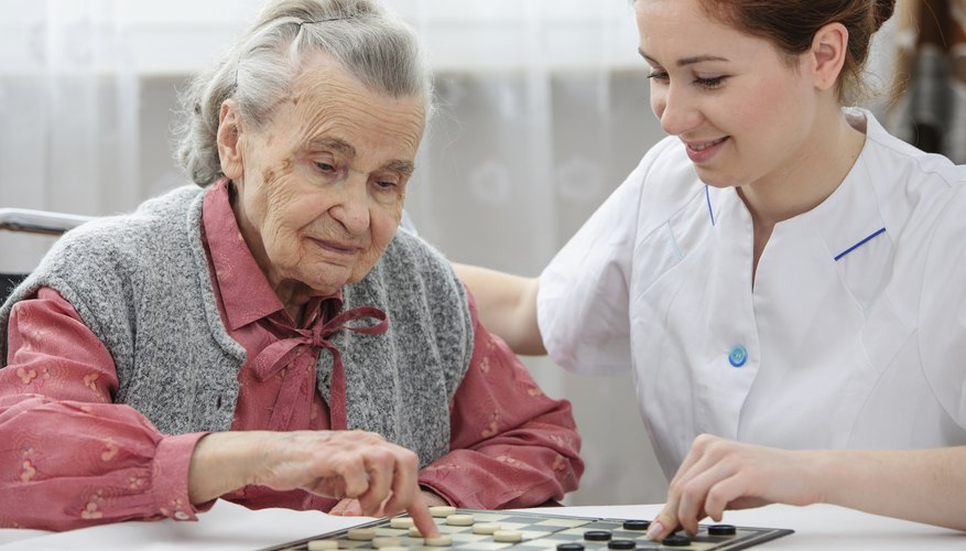 Senior playing checkers with a nurse