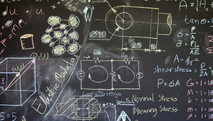 Formulas pertaining to electronics on a classroom chalkboard.