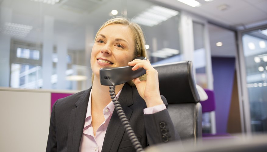Pretty Businesswoman telephoning in her office