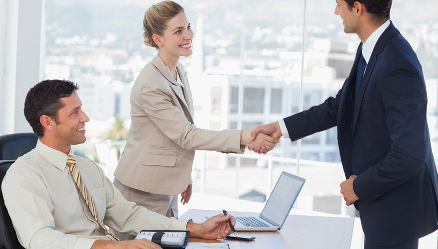 Business people shaking hands with their future patner