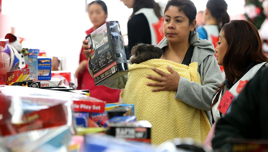 Salvation Army volunteers handing out toys to families in need.