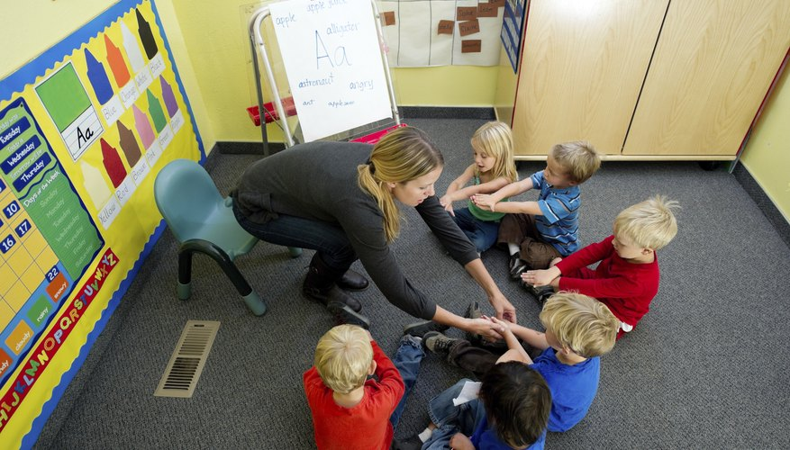 A teacher guides toddlers in a circle