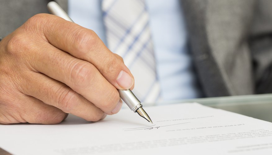 Businessman is Signing a Contract, focus on pen