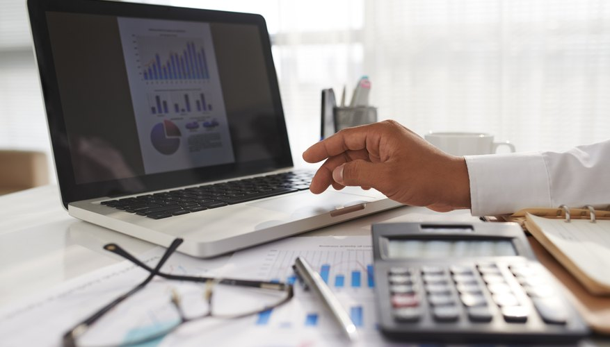 Financial manager working on laptop in office