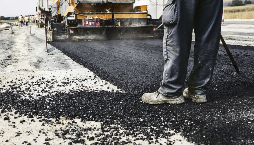 Asphalt being laid for road construction.