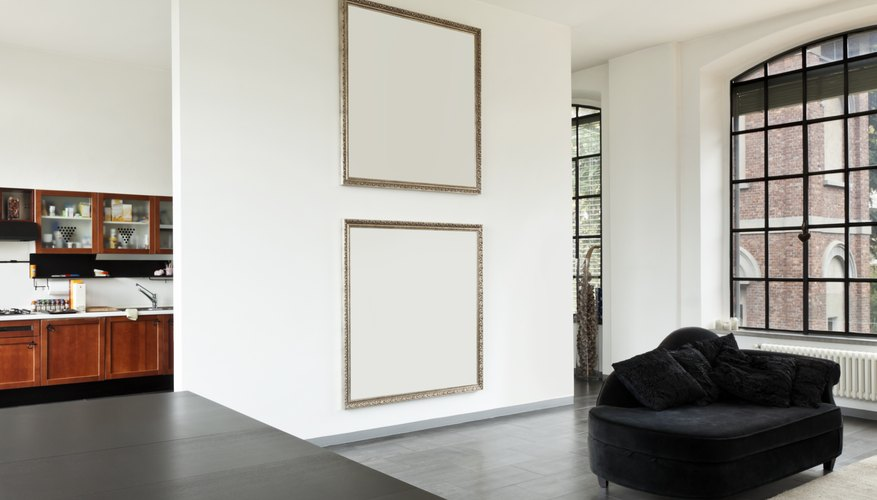 Framed pictures on wall.