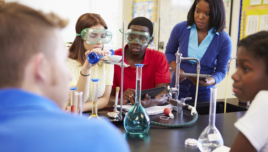 A science teacher guides her students through an experiment in a classroom