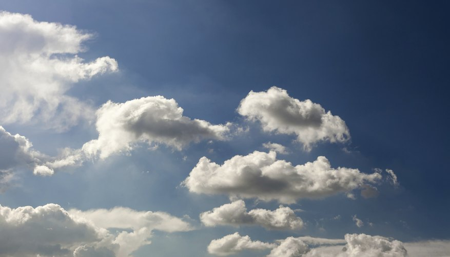 White clouds form and drift in the blue sky.
