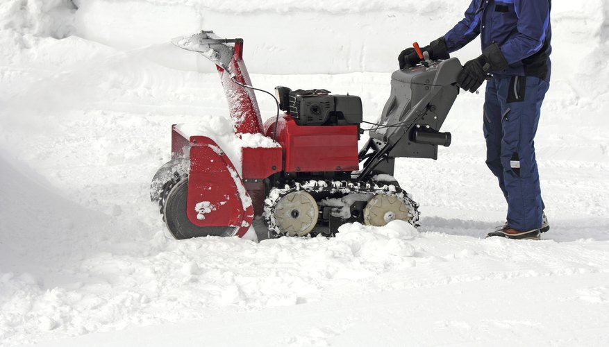 A man using a dual-stage snowblower