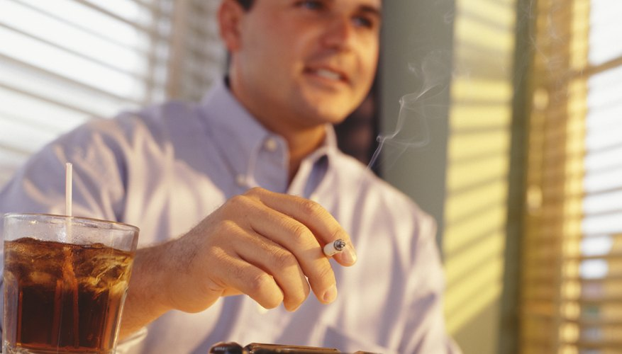Man smoking and drinking