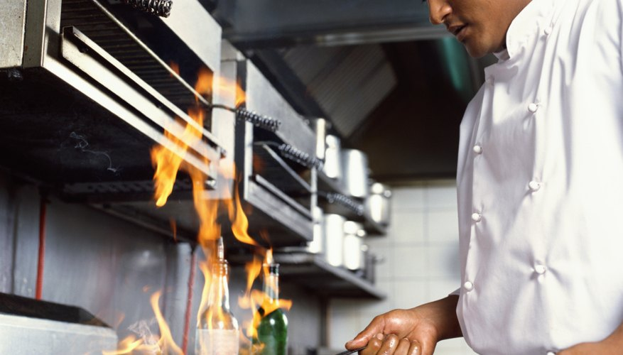 side profile of a chef cooking food in the kitchen