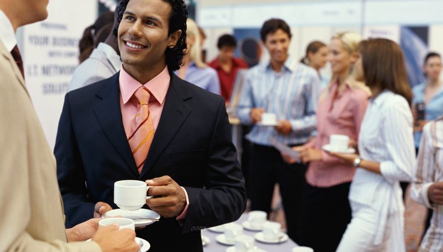 two businessmen at an even having coffee