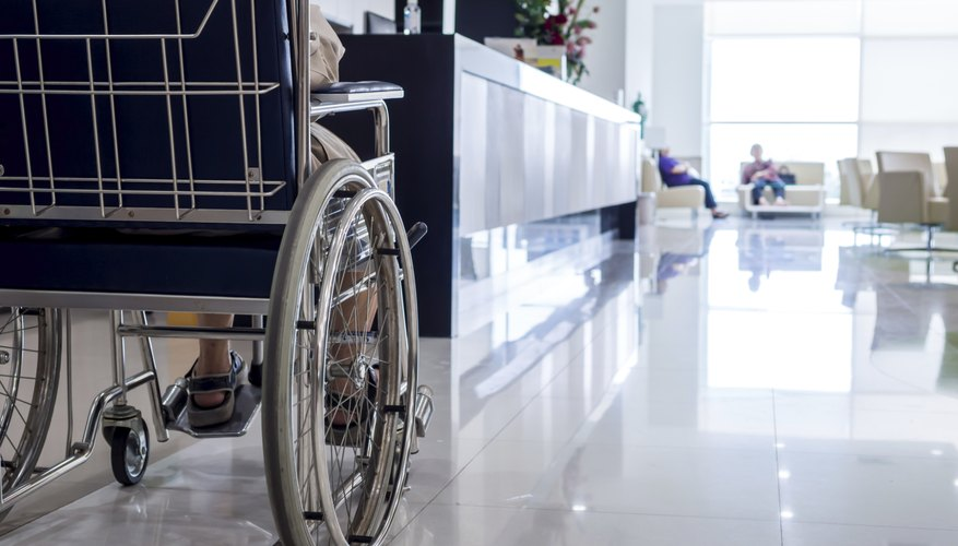 A close-up of a disabled person in a hospital corridor.
