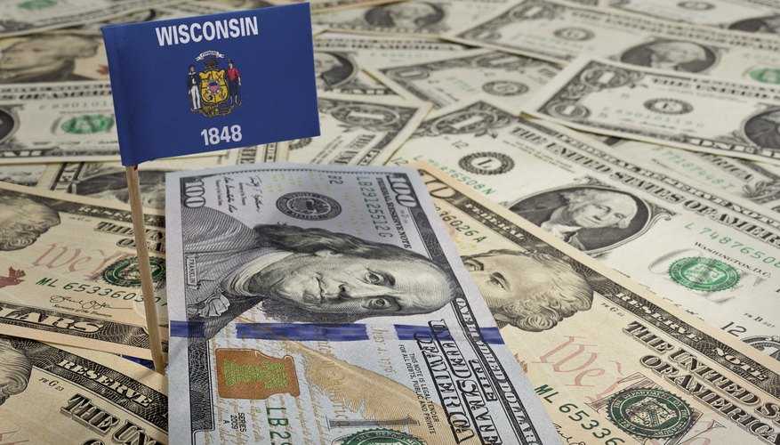 Flag of Wisconsin sticking in various american banknotes.(series