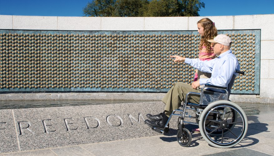 Image of a veteran and granddaughter looking at WWII Memorial.