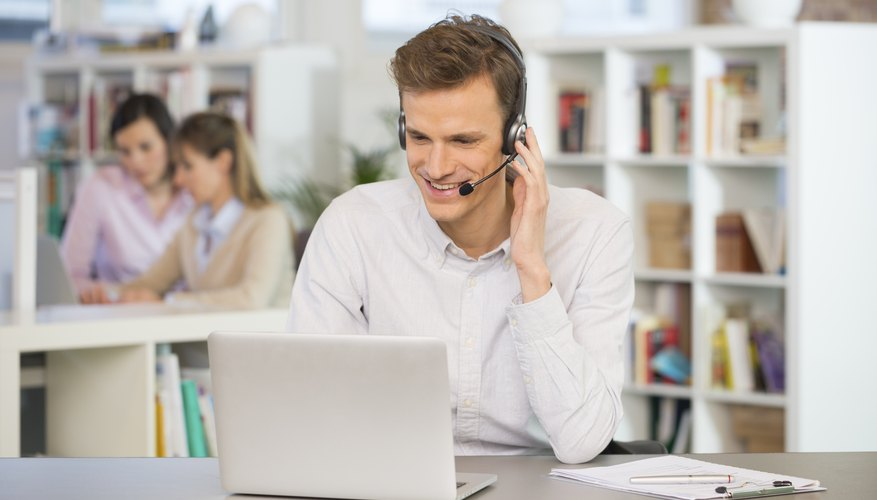 Happy Businessman at office on the phone, headset, Skype