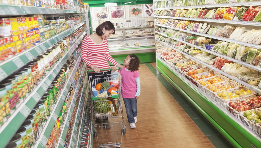 Mother and daughter shopping in a grocery store.