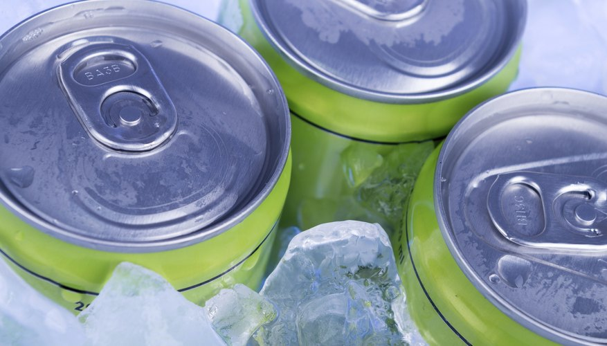 Close-up of frozen soda cans in ice
