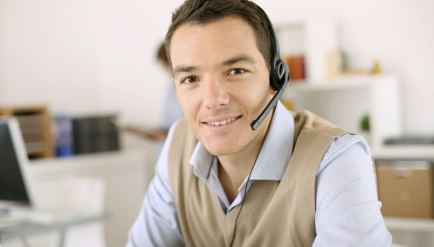 Young man  with head phone at work providing customer service