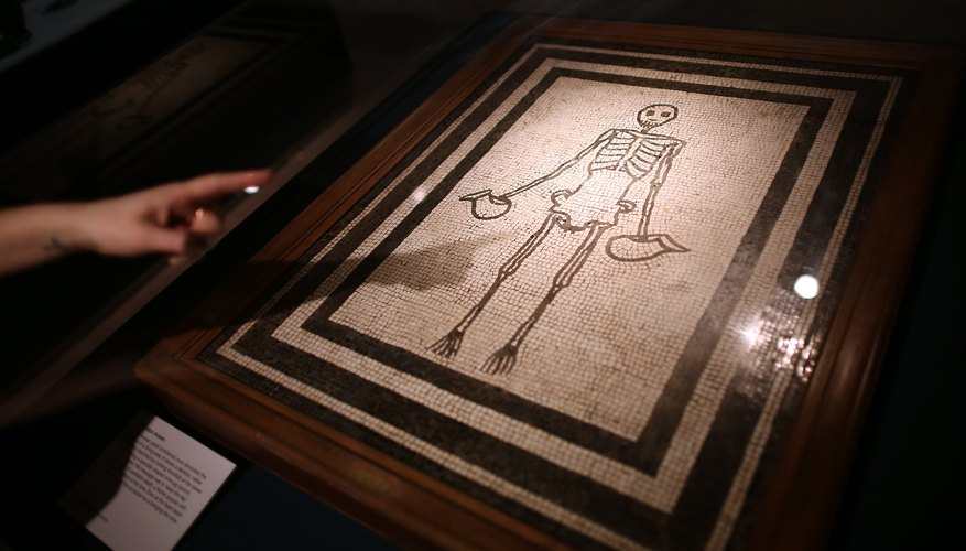 Roman mosaic of a skeleton on display in London museum