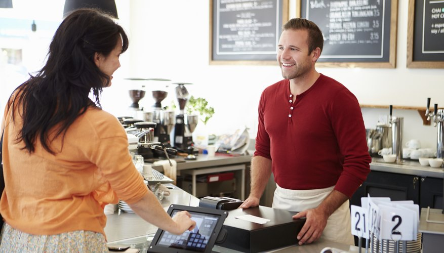 Customer Paying In Coffee Shop