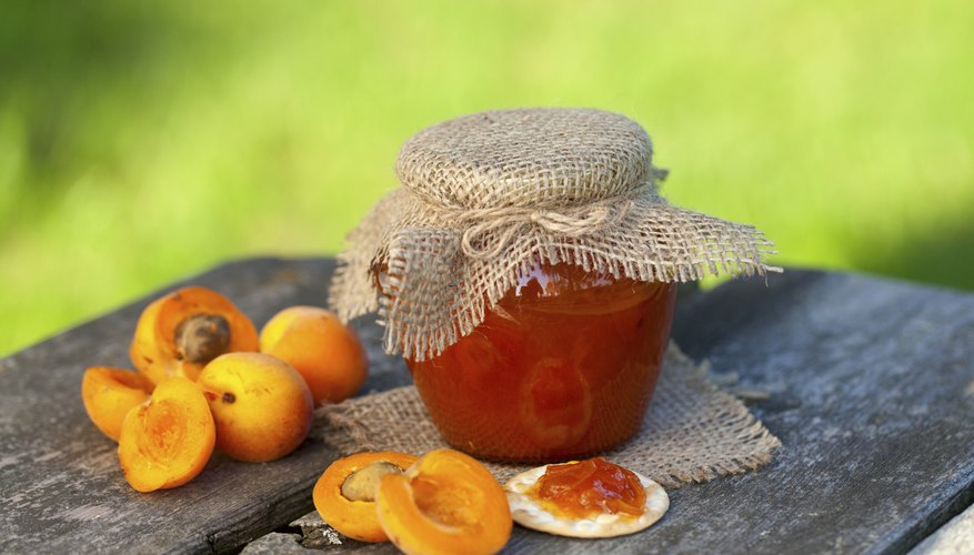 apricot jam on a wooden bowl